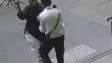 Hassan Khalif Shire Ali raises his arm to stab the security guard.