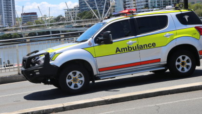 Driver dies in three-car and truck crash on major Brisbane road