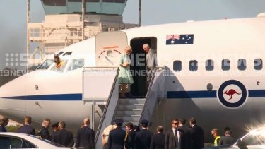 Prince Charles and his wife the Duchess of Cornwall boarding a flight from Wagga Wagga to Queensland ahead of the Commonwealth Games on Wednesday.