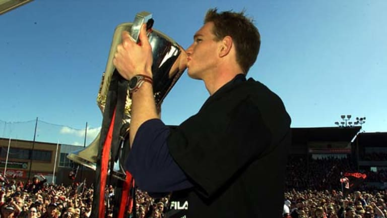 Former Essendon captain James Hird with the 2000 premiership cup at Windy Hill.