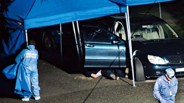 Michael McGurk's body lies beside his car after the murder in Cremorne in September 2009.