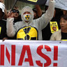 Malaysians gather outside Lynas Corporations Annual General Meeting in Sydney on Tuesday, to oppose the company's rare earth processing plant in Kuantan. Image lauren farrow  AAP