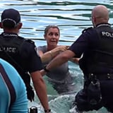 Protesters and police in the water at Sea World on Saturday.