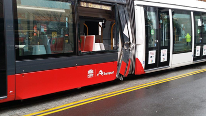 Tram badly damaged after collision with truck in George Street