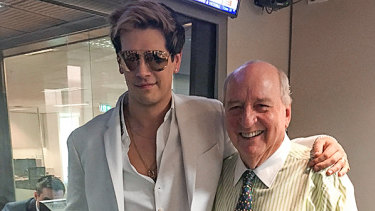 Controversial political commentator Milo Yiannopoulos (L) poses for a photo with radio broadcaster Alan Jones.
