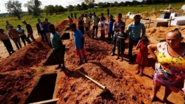 Relatives of farmers killed by Brazilian police attend their burial in 2017.
