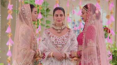 A lesbian wedding on mainstream Indian TV? Practically unheard of. Lisa Ray, right, plays the girlfriend of Umang (Bani J, left, with Kulhari, centre).