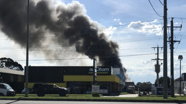Fire burns out-of-control at food processing factory.