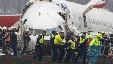Resue workers attending to the remains of the Turkish Airlines Boeing 737 passenger jet in 2009.