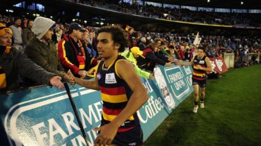 Tony Armstrong celebrates a win with the Adelaide Crows.