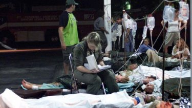 An Australian air force medic sits with injured Australians awaiting evacuation after the 2002 bombing.