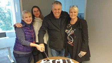 Ray Hadley cutting his celebration cake without Alan Jones.