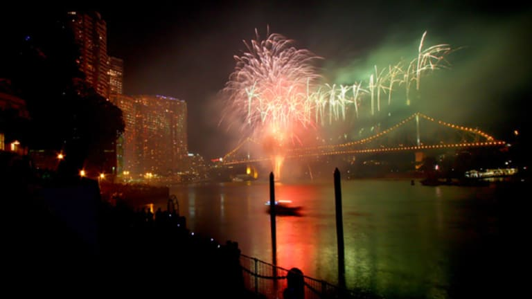 Brisbane city lights up under the spectacular fireworks display of Riverfire.