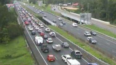 The Bruce Highway northbound congestion as commuters escape from Brisbane for the Australia Day long weekend.