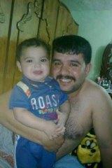 Ghanim al-Shnen with his son Ali in Iraq.