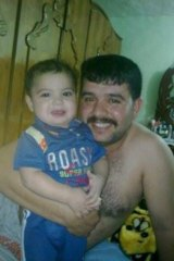 Ghanim al-Shnen with his son Ali in Iraq.