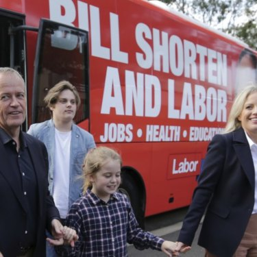 Bill and Chloe Shorten exit the campaign bus with their children Rupert and Clementine.