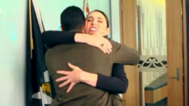 Jacinda Ardern hugs Waleed Aly ahead of their interview.