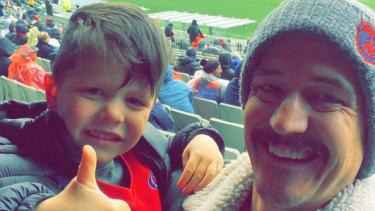 Joel Pearce with son Cruz at the MCG.