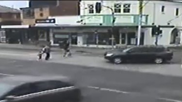 The car drives towards the pedestrians.