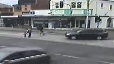 The car drives towards the pedestrians.