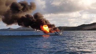 The yacht burns off Moreton Island on Friday morning.