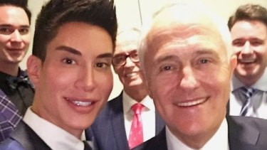 """""""Human Ken Doll"""" and social media personality Justin Jedlica with former prime minister Malcolm Turnbull."""