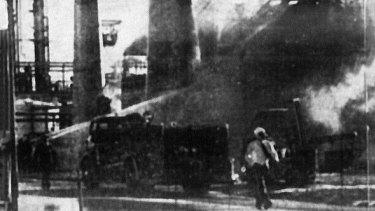Firefighters battle the intense flames.
