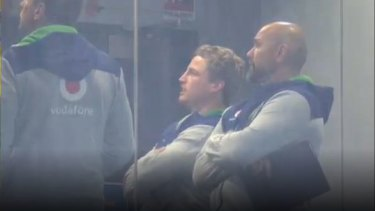 Brett Finch in the Warriors' coaching box during their clash with the Panthers on Friday.