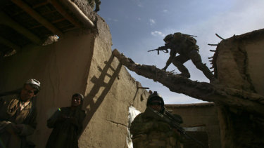 Australian and ANA soldiers search a Qala compound in Chora, Afghanistan.
