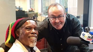 Happier times: 2GB host Chris Smith, right, recently had music legend Billy Ocean on his show.