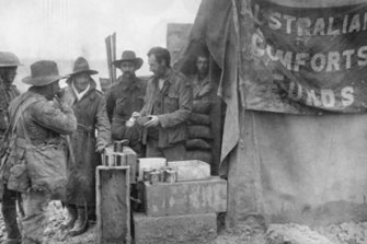 Diggers drinking coffee at an Australian Comfort Funds stall.