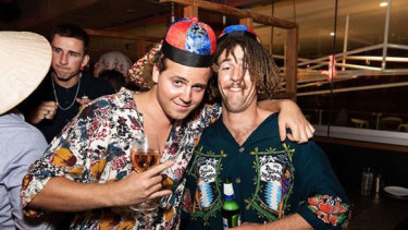 Tom Tilley, pictured on the left with a friend, is a chip off the old block who has inherited his father Ben Tilley's love of a party.