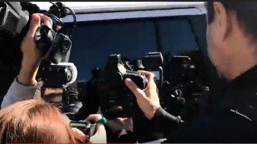 Media surround the van holding serial killer Ivan Milat.