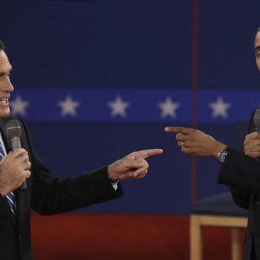 Mitt Romney and President Barack Obama spar during the second presidential debate in October 2012.