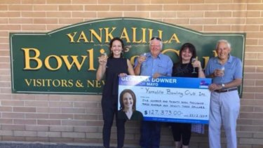 Liberal candidate Georgina Downer presents a cheque to the Yankalilla Bowling Club in February.