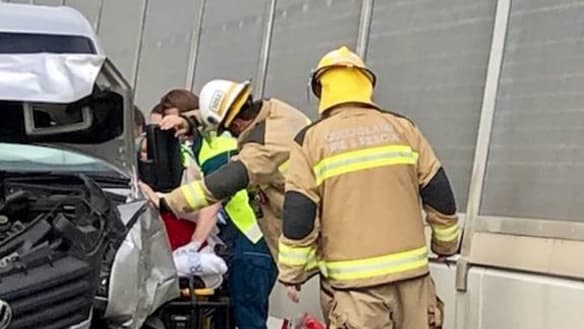 Car, minibus crash on Gateway Bridge, 10 people in hospital