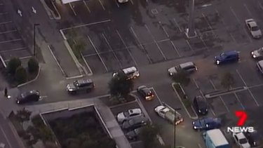 Officers search cars leaving the Woolworths complex at Pimpama.