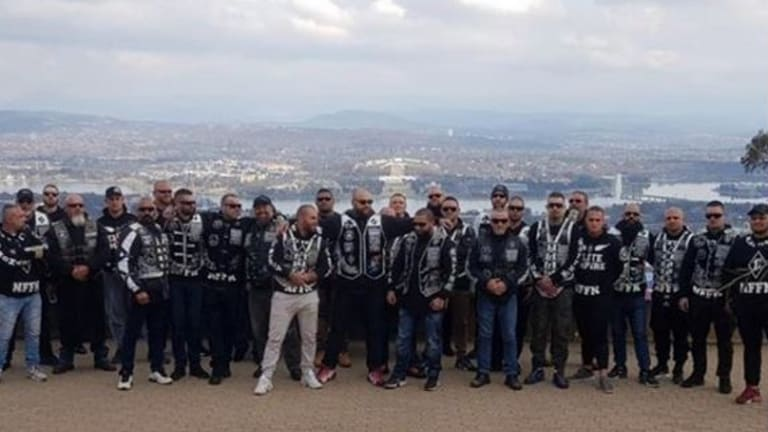 Nomads OMCG members pose for pictures on Mount Ainslie during a meeting in Canberra over the weekend.