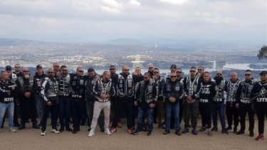 Nomads OMCG members pose for pictures on Mount Ainslie during a meeting in Canberraover the weekend.