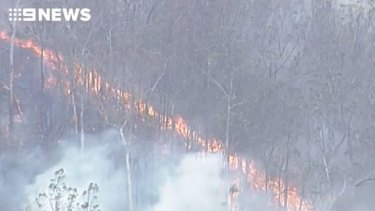 Fire has been crawling across the landscape around Pechey north of Toowoomba, over the weekend