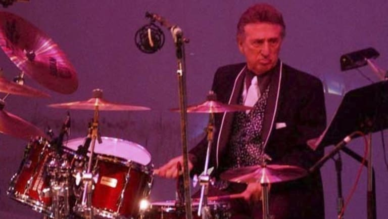 Elvis Presley drummer D.J. Fontana performs at the 50th anniversary celebration concert of Elvis Presley\'s first performance at the Louisiana Hayride in Sherveport, Louisiana.