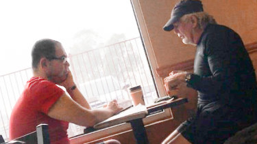 An IBAC surveillance photo of Casey councillor Sam Aziz (left) and developer John Woodman (right) at a Subway restaurant in April 2018.