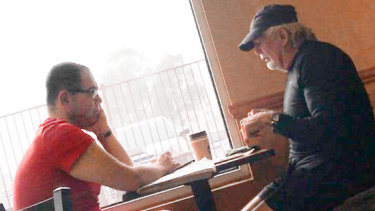 Casey councillor Sam Aziz (L) and developer John Woodman (R) meet at a Subway restaurant in April 2018.