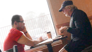 An IBAC surveillance photo of Casey councillor Sam Aziz (L) and developer John Woodman (R) at a Subway restaurant in April 2018.