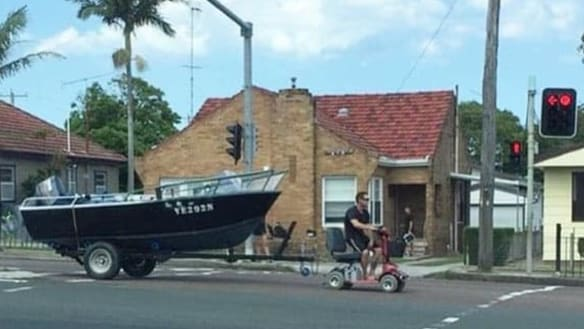 Man charged for using mobility scooter to tow boat down Pacific Highway