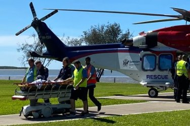 The shark attack victim was flown to Cairns Hospital by a QGAir helicopter.