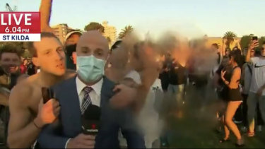Seven News footage at St Kilda beach on Friday evening.