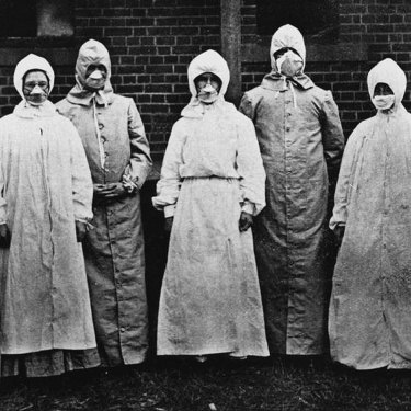Dr Burnett Ham and his medical and nursing staff wore specially designed overalls and respirators when dealing with the sick.