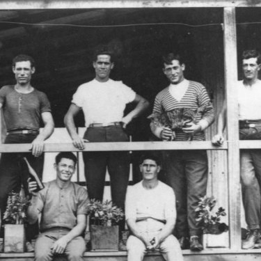 Costante Danesi (top left) poses with other Italian canecutters on a verandah. . Back row: C. Danesi, P. D'Urso, G. Pappalardo, V. Barbagallo and A. Barbagallo. Front row: R. Spina, A. D'Urso, A. Sapunno and G Palazzolo.